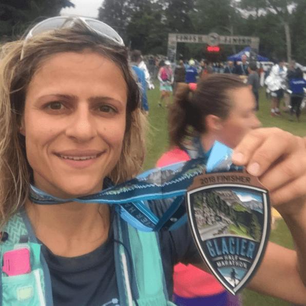 Image of a Glacier Half Marathon runner with her medal
